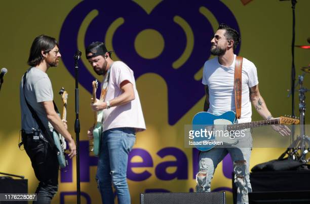 Geoff Sprung Matthew Ramsey and Brad Tursi of Old Dominion perform onstage during the Daytime Stage at the 2019 iHeartRadio Music Festival held at...