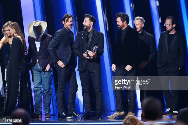 Geoff Sprung Matthew Ramsey Brad Tursi Trevor Rosen and Whit Sellers of Old Dominion accept an award onstage during the 53rd annual CMA Awards at the...