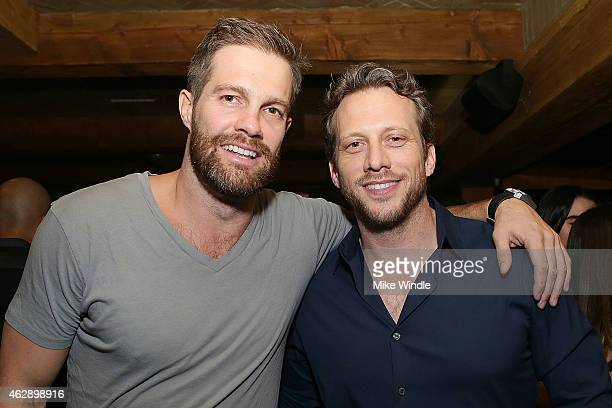 Geoff Stults and Ari Sandel attend the Yellowtail Sunset Grand Opening on February 6 2015 in West Hollywood California