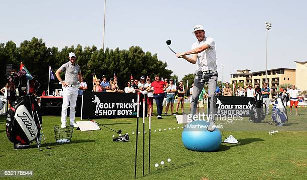 Geoff Swain and Kevin Carpenter of the Golf Trickshot Boys pictured with Chris Wood of England during day two of the Abu Dhabi HSBC Championship at...