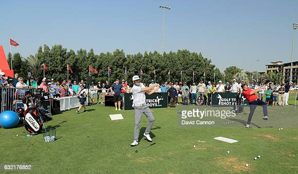 Geoff Swain of England and Kevin Carpenter of England the 'Golf Trick Shot Boys' performing on the range during the second round of the 2017 Abu...