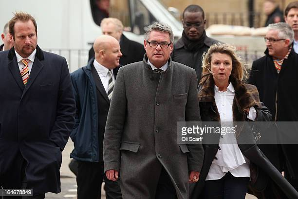Geoff Webster , the deputy editor of the Sun newspaper, arrives at Westminster Magistrates Court with his wife Alison Webster and reporters from the...