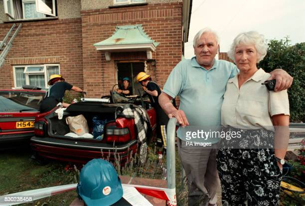 Geoffrey and Dorothy Hayler residents of the upstairs flat look on as firEmen check a car in Downland Drive after the car containing three elderly...