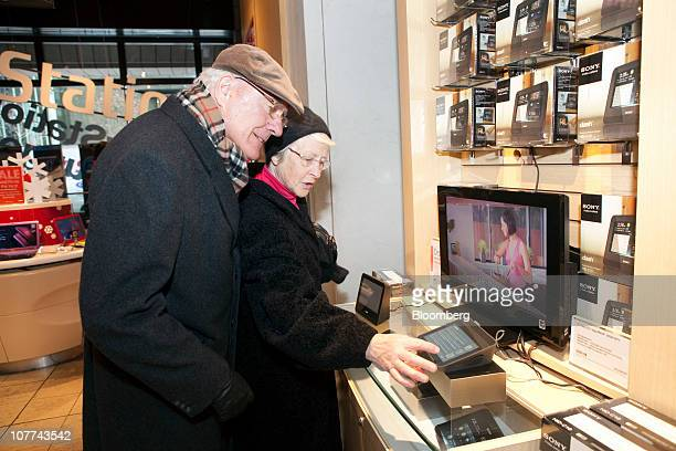 Geoffrey and Margaret Palmer shop for Sony Corp Personal Internet Viewers at the Sony Style Store in New York US as the Christmas holiday approaches...