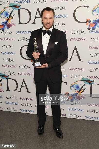 Geoffrey Beene lifetime achievement award recipient Tom Ford attends the winners walk during the 2014 CFDA fashion awards at Alice Tully Hall Lincoln...