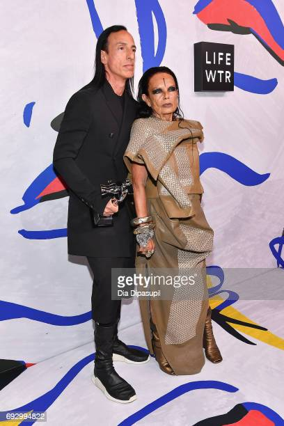 Geoffrey Beene Lifetime Achievement Award Winner Rick Owens and Michele Lamy pose on the LIFEWTR Winner's Walk at the CFDA Awards 2017 on June 5 2017...