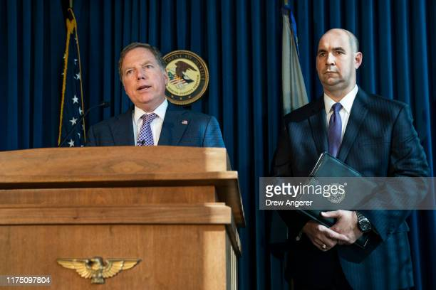 Geoffrey Berman US Attorney for the Southern District of New York speaks as William F Sweeney assistant directorincharge of the New York Office of...