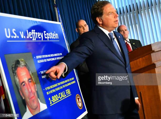 Geoffrey Berman US attorney for the Southern District of New York speaks while standing next to a poster displaying the image of fund manager Jeffrey...