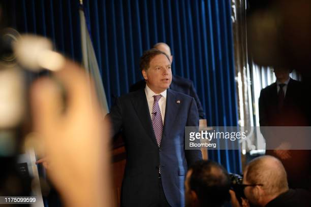 Geoffrey Berman US attorney for the Southern District of New York center speaks during a news conference in New York US on Thursday Oct 10 2019...