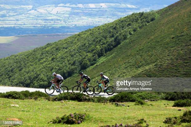 Geoffrey Bouchard of France and AG2R Citröen Team, Romain Bardet of France and Team DSM & Mikel Nieve Ituralde of Spain and Team BikeExchange passing...