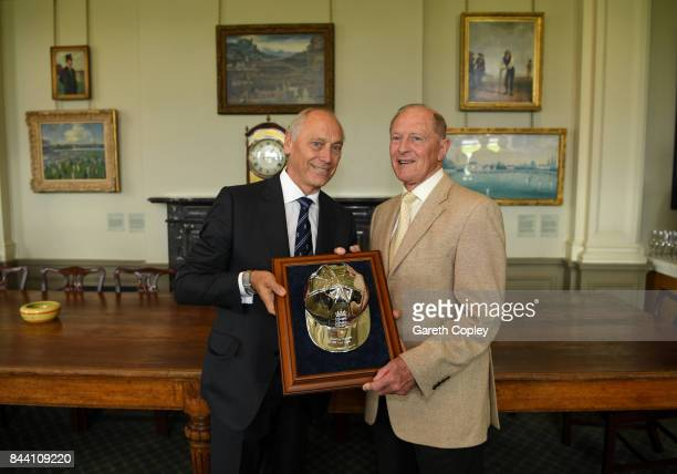 Geoffrey Boycott receives a silver cap from ECB Chairman Colin Graves to commemorate reaching 100 test caps for England during the lucnch break on...