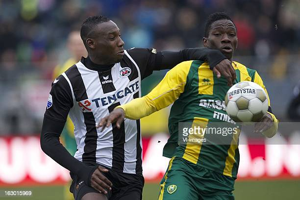 Geoffrey Castillion of Heracles Almelo Dion Malone of ADO Den Haag during the Dutch Eredivisie match between ADO Den Haag and Heracles Almelo at the...