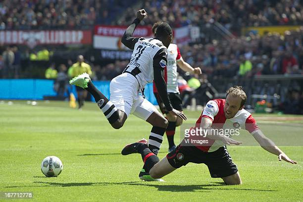 Geoffrey Castillion of Heracles Almelo Joris Mathijsen of Feyenoord during the Dutch Eredivisie match between Feyenoord and Heracles Almelo on April...