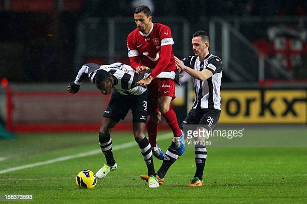 Geoffrey Castillion of Heracles Almelo Nacer Chadli of FC Twente Thomas Bruns of Heracles Almelo during the Dutch Eredivisie match between FC Twente...