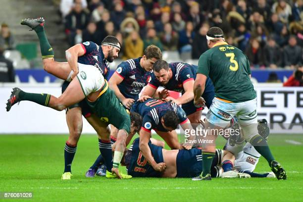 Geoffrey Doumayrou of France clears Francois Venter of South Africa out of a ruck during the test match between France and South Africa at Stade de...