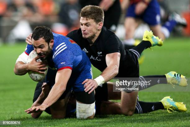 Geoffrey Doumayrou of France is tackled by Beauden Barrett of New Zealand during the International Test match between the New Zealand All Blacks and...