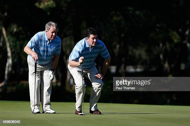 Geoffrey Hands and Brian Rimmer of Little Aston Golf Club lineup a putt during day one of The Golfplan Insurance Pro Captain Challenge grand final at...