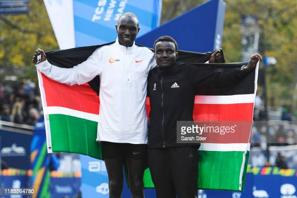 Geoffrey Kamworor and Joyciline Jepkosgei of Kenya pose with the Kenyan flag after winning the Mens' and Womens' Division of the 2019 TCS New York...