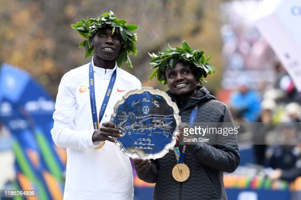 Geoffrey Kamworor and Joyciline Jepkosgei of Kenya pose with the trophy after winning the Mens' and Womens' Division of the 2019 TCS New York City...