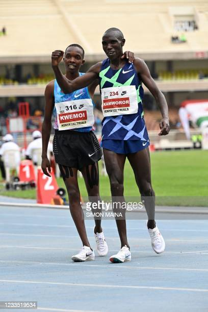 Geoffrey Kamworor, celebrates with with Rodgers Kwemoi after winning the men's 10000M finals during second day of the trials for the Tokyo Olympic...