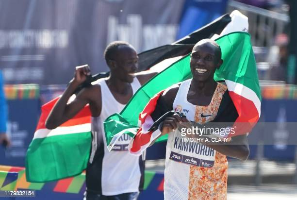 Geoffrey Kamworor of Kenya and second place finisher and Albert Korir of Kenya cheer after they finish the Professional Men's Finish during the 2019...