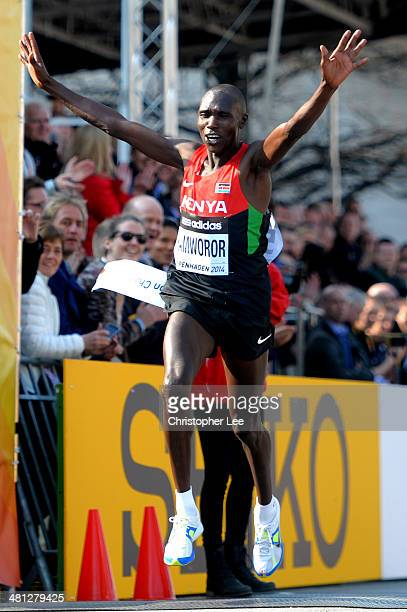 Geoffrey Kamworor of Kenya celebrates victory as he crosses the finish line in first place during the IAAF/AlBank World Half Marathon Championships...