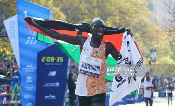 Geoffrey Kamworor of Kenya cheers after he crosses the finish line to win the Professional Men's Finish during the 2019 TCS New York City Marathon in...