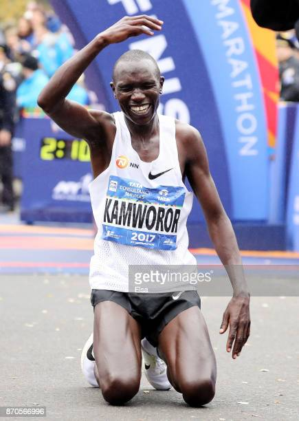 Geoffrey Kamworor of Kenya crosses the finish line as he wins the Professional Men's Division during the 2017 TCS New York City Marathon in Central...