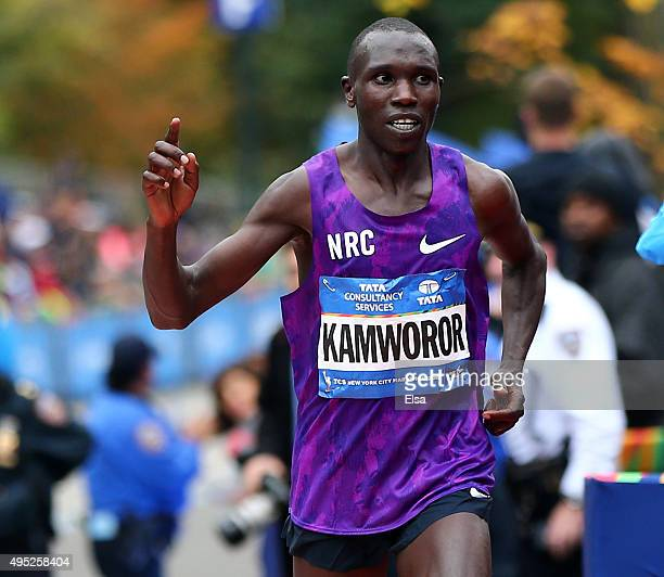 Geoffrey Kamworor of Kenya crosses the finish line in second place during the TCS New York City Marathon on November 1 2015 in New York City