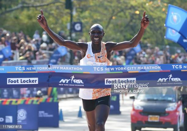 Geoffrey Kamworor of Kenya crosses the finish line to win the Professional Men's Finish during the 2019 TCS New York City Marathon in New York on...