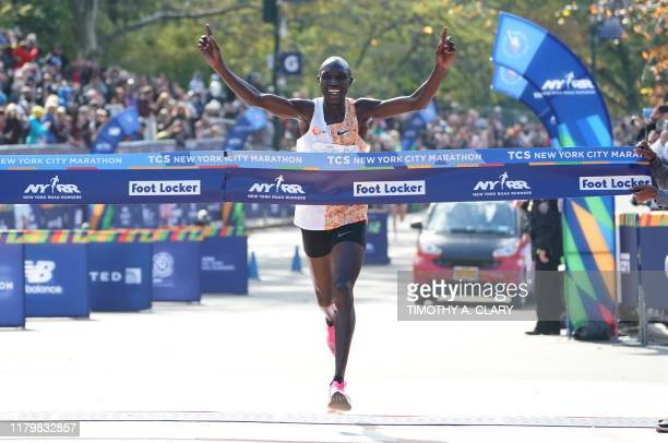 TOPSHOT Geoffrey Kamworor of Kenya crosses the finish line to win the Professional Men's during the 2019 TCS New York City Marathon in New York on...