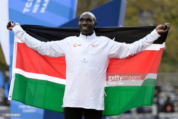 Geoffrey Kamworor of Kenya poses with the Kenyan flag after winning the Men's Division of the 2019 TCS New York City Marathon on November 03 2019 in...