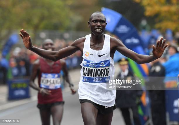 Geoffrey Kamworor of Kenya reacts after crossing the finish line to win the Men's Division during the 2017 TCS New York City Marathon in New York on...