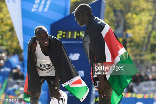 Geoffrey Kamworor of Kenya right reacts with Albert Korir of Kenya after finishing in the top two of the Men's Division of the 2019 TCS New York City...