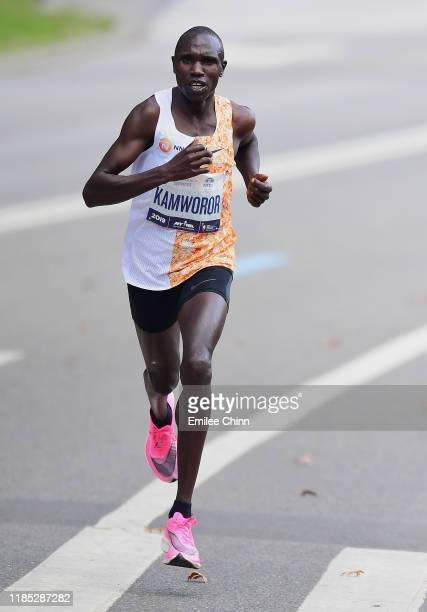 Geoffrey Kamworor of Kenya runs through Central Park before finishing first in the Mens' Professional Division in the TCS New York City Marathon on...