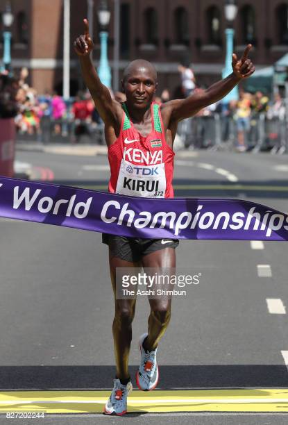 Geoffrey Kipkorir Kirui of Kenya crosses the finish tape to win the gold medal in the Men's Marathon during day three of the 16th IAAF World...