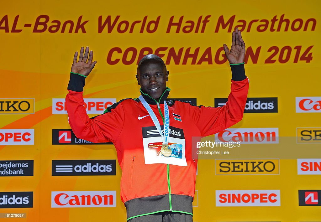 Geoffrey Kipsang Kamworor of Kenya celebrates with his gold medal after winning the Men's Half Marathon during the IAAF/Al-Bank World Half Marathon Championships on March 29, 2014 in Copenhagen, Denmark.