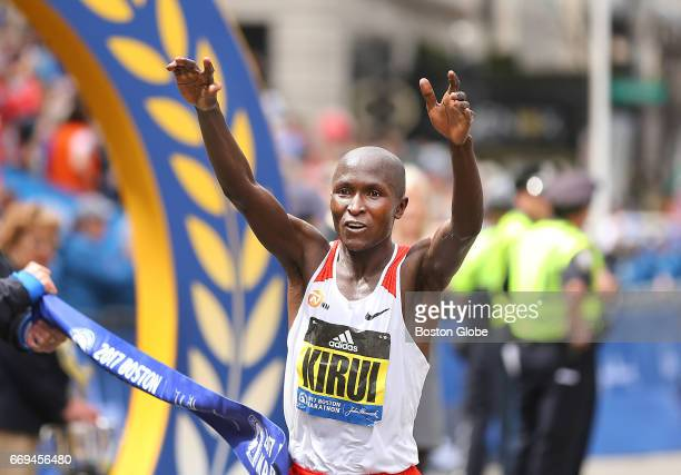 Geoffrey Kirui breaks the finish line tape to win the men's race in the 121st Boston Marathon on April 17 2017