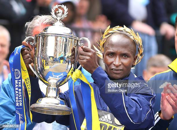 Geoffrey Kirui men's winner holds up the trophy after finishing the 121st Boston Marathon on April 17 2017