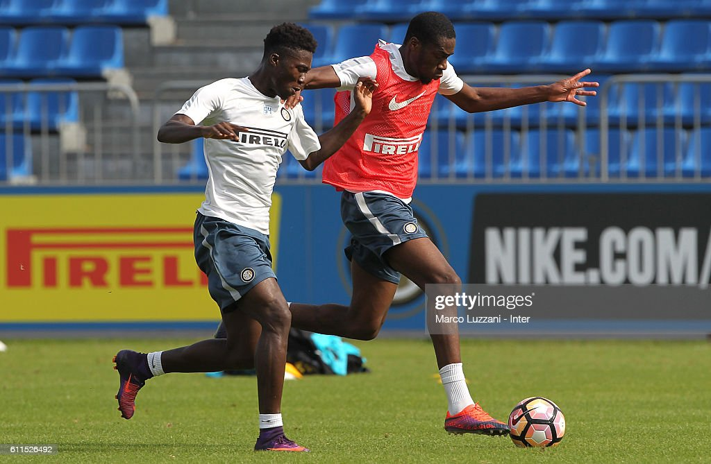 Geoffrey Kondogbia (R) is challenged by Eloge Koffi Yao Guy (L) during the FC Internazionale training session at the club's training ground 'La Pinetina' on September 30, 2016 in Como, Italy.