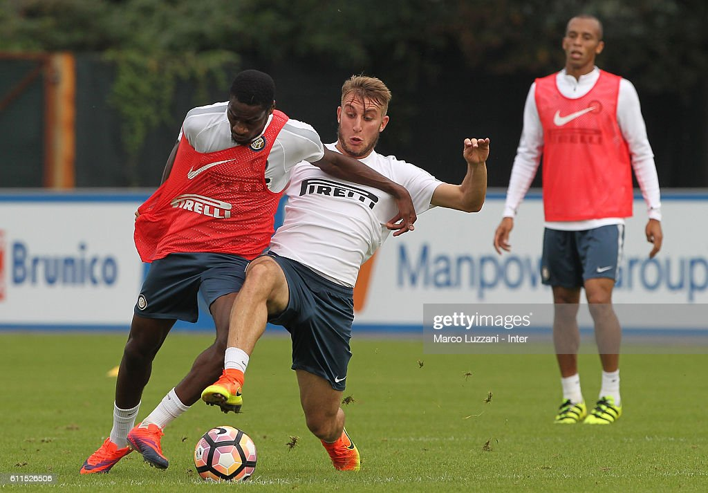 Geoffrey Kondogbia is challenged by Loris Zonta during the FC Internazionale training session at the club's training ground 'La Pinetina' on September 30, 2016 in Como, Italy.