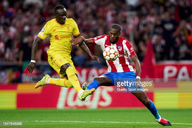 Geoffrey Kondogbia of Atletico de Madrid battles for the ball with Sadio Mane of Liverpool FC during the UEFA Champions League group B match between...