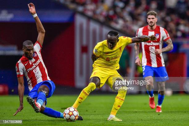Geoffrey Kondogbia of Club Atletico de Madrid and Sadio Mane of Liverpool FC during the Group B - UEFA Champions League match between Club Atletico...