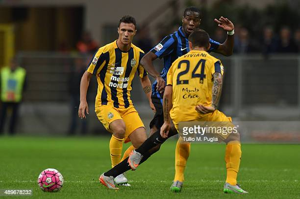 Geoffrey Kondogbia of Internazionale Milano holds off the challenge from Luca Siligardi and Federico Viviani of Hellas Verona compete for the ball...