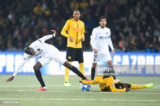 Geoffrey Kondogbia of Valencia and Roger Assale of Bern during the UEFA Champions League match between Young Boys Berne and Valence CF on October 23...