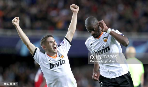 Geoffrey Kondogbia of Valencia celebrates after scoring his team's third goal with Daniel Parejo during the UEFA Champions League group H match...