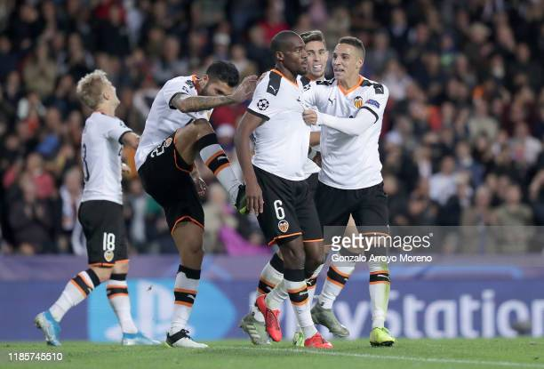 Geoffrey Kondogbia of Valencia celebrates with teammates after scoring his team's third goal during the UEFA Champions League group H match between...