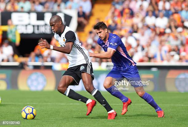 Geoffrey Kondogbia of Valencia CF and Gabriel Pires of Club Deportivo Leganes in action during the La Liga match between Valencia CF and Club...