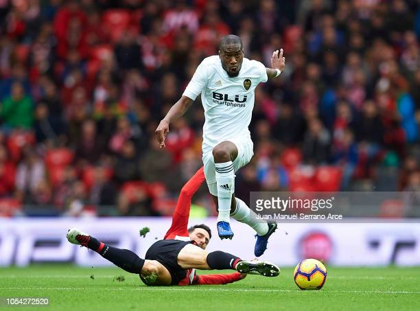 Geoffrey Kondogbia of Valencia CF competes for the ball with Aritz Aduriz of Athletic Club during the La Liga match between Athletic Club and...