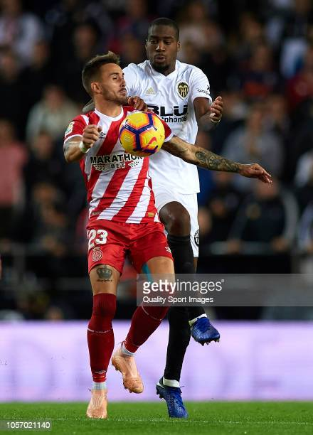 Geoffrey Kondogbia of Valencia competes for the ball with Aleix Garcia of Girona during the La Liga match between Valencia CF and Girona FC at...